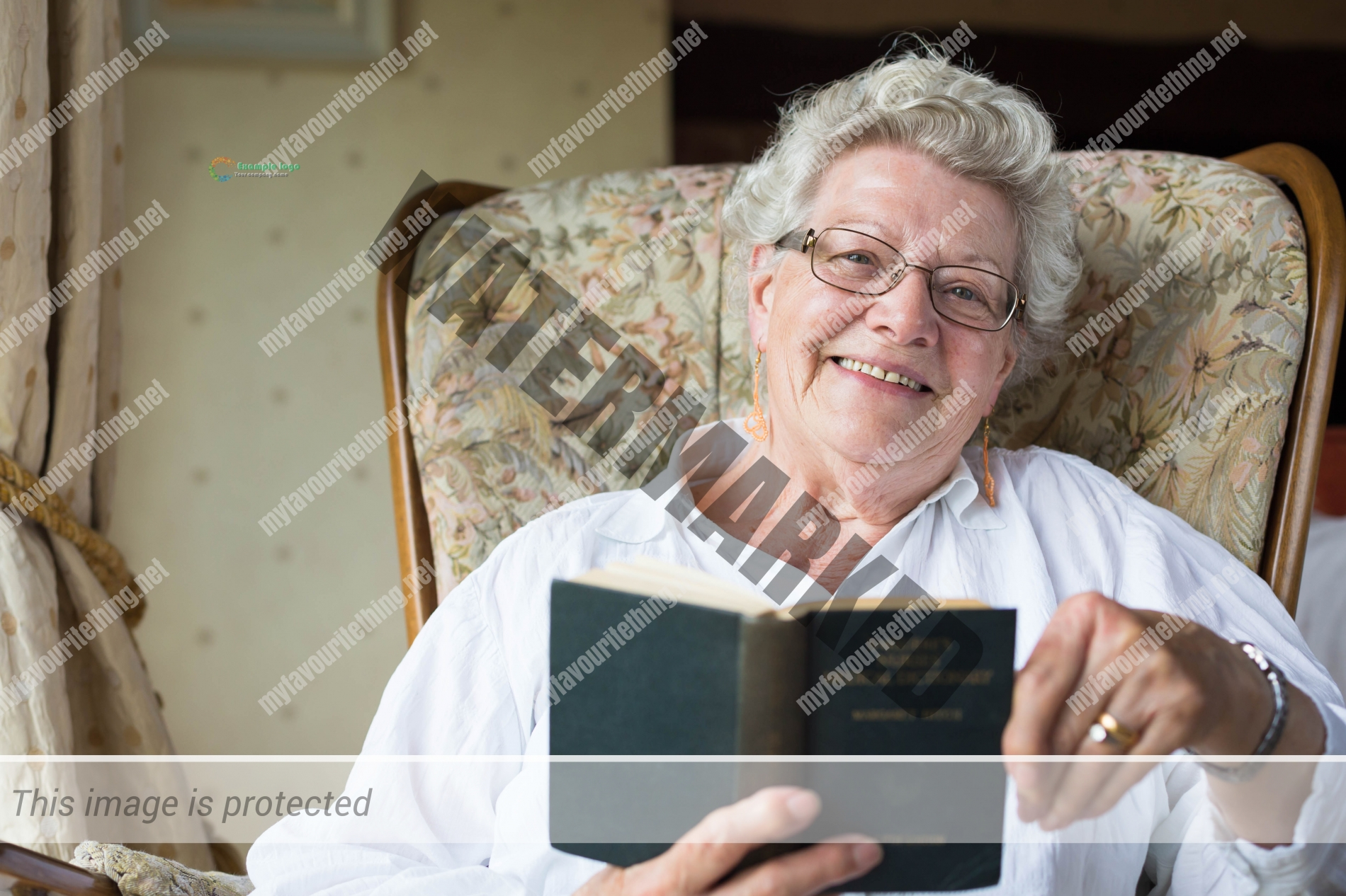Retired midwife Betty MacKinnon with her Bailliere's Nurses Dictionary