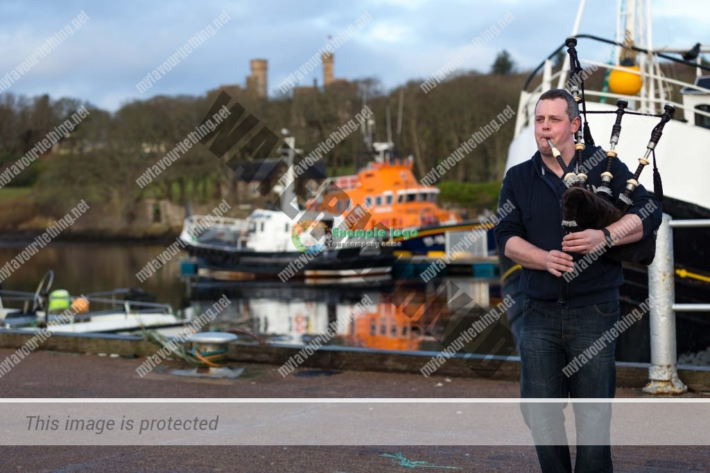 Ross Macrae playing bagpipes at Stornoway Harbour, Isle of Lewis