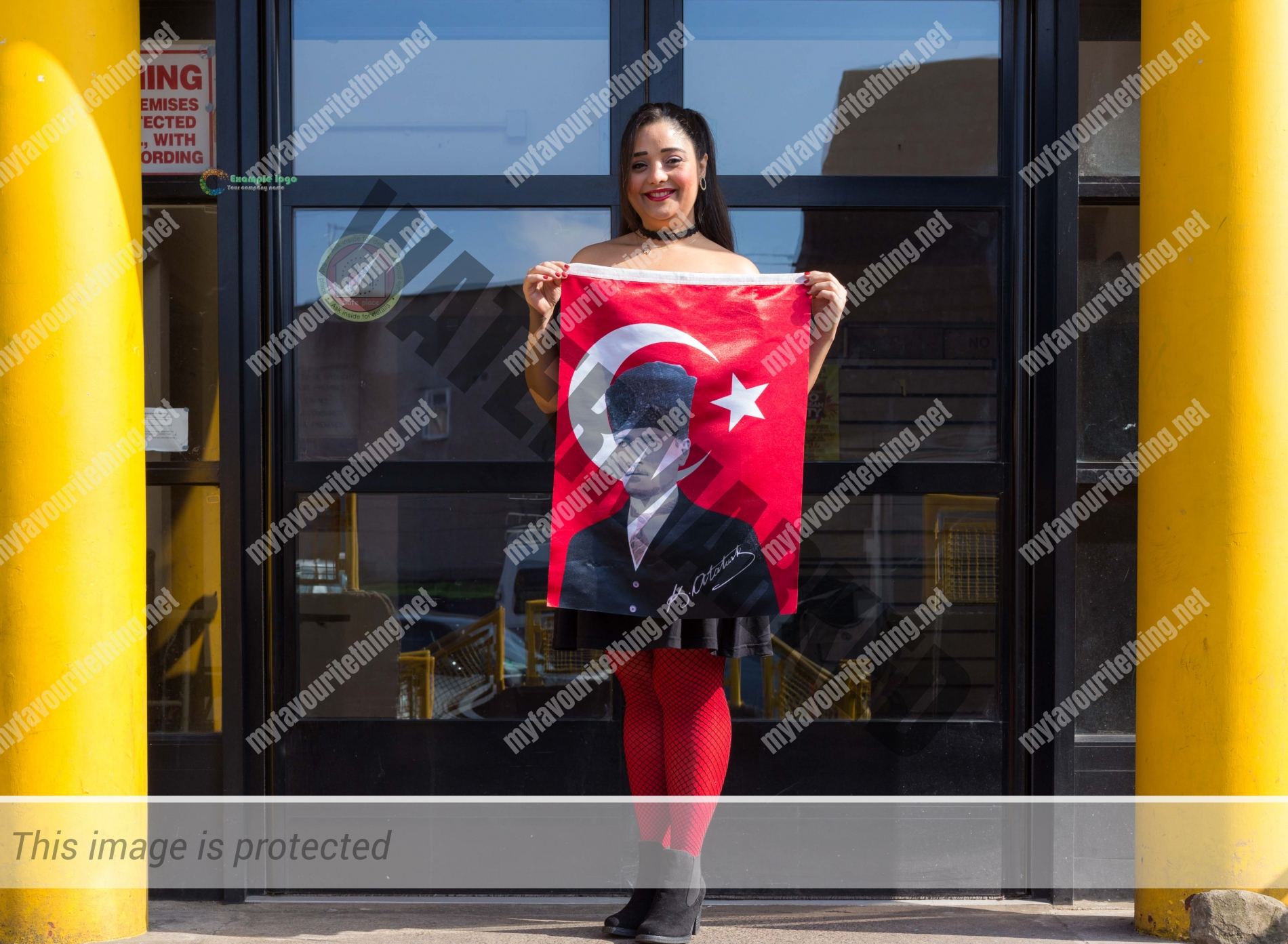 Flautist Koza Unal with the flag of Turkey featuring Ataturk, outside the Malcolm X Centre in Bristol